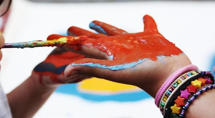 painting kids hand