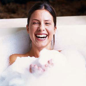 woman in tub bath salts
